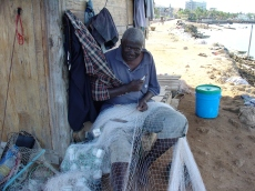 Fisherman mending nets Dar es Salaam