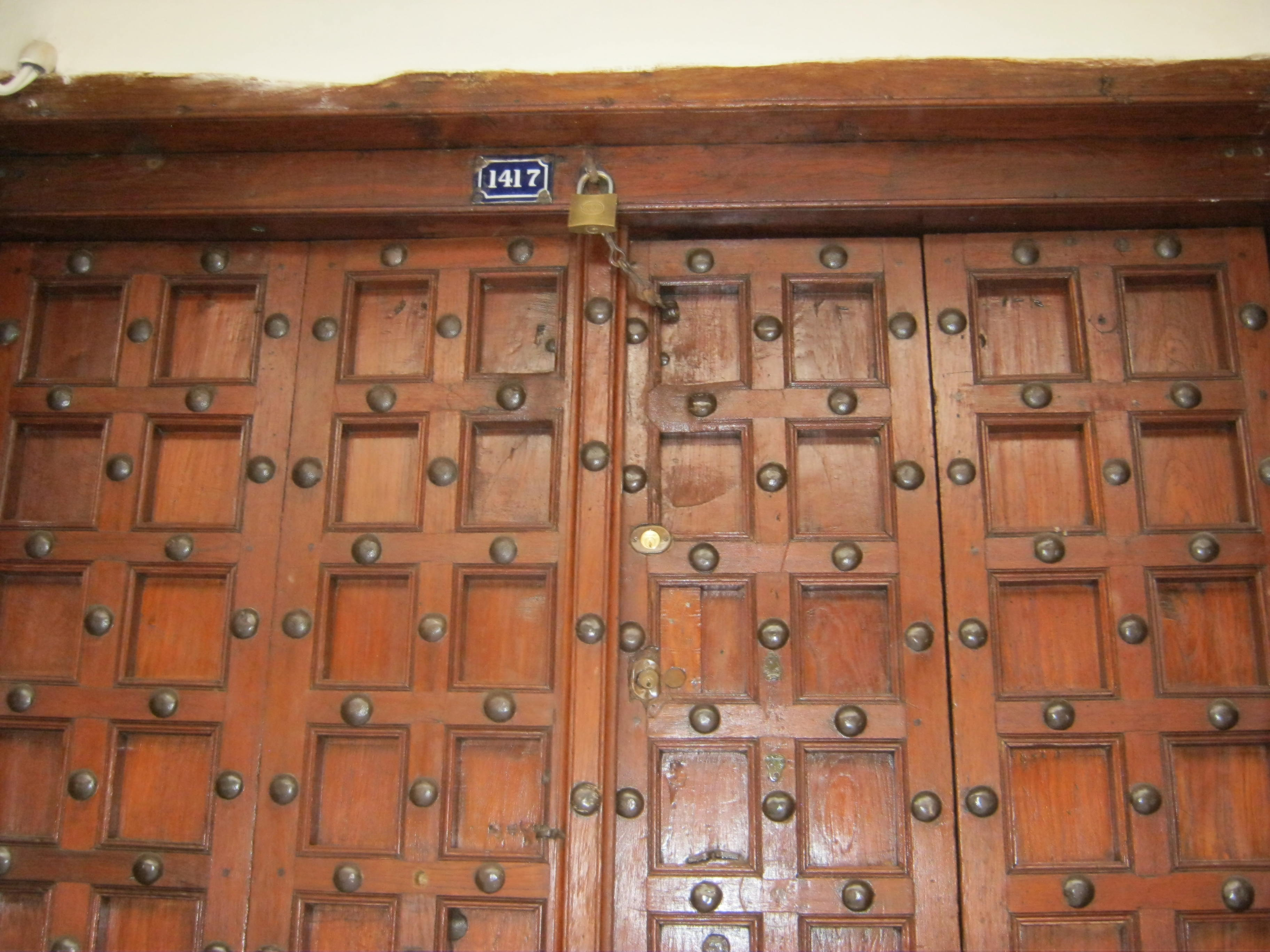 Another type of Indian door is the Punjabi door. These doors are distinguished by the arched top of the frame and heavy brass studs that jut out from the ... & Zanzibar Doors : A Carved Business Card | purpleviolas pezcame.com