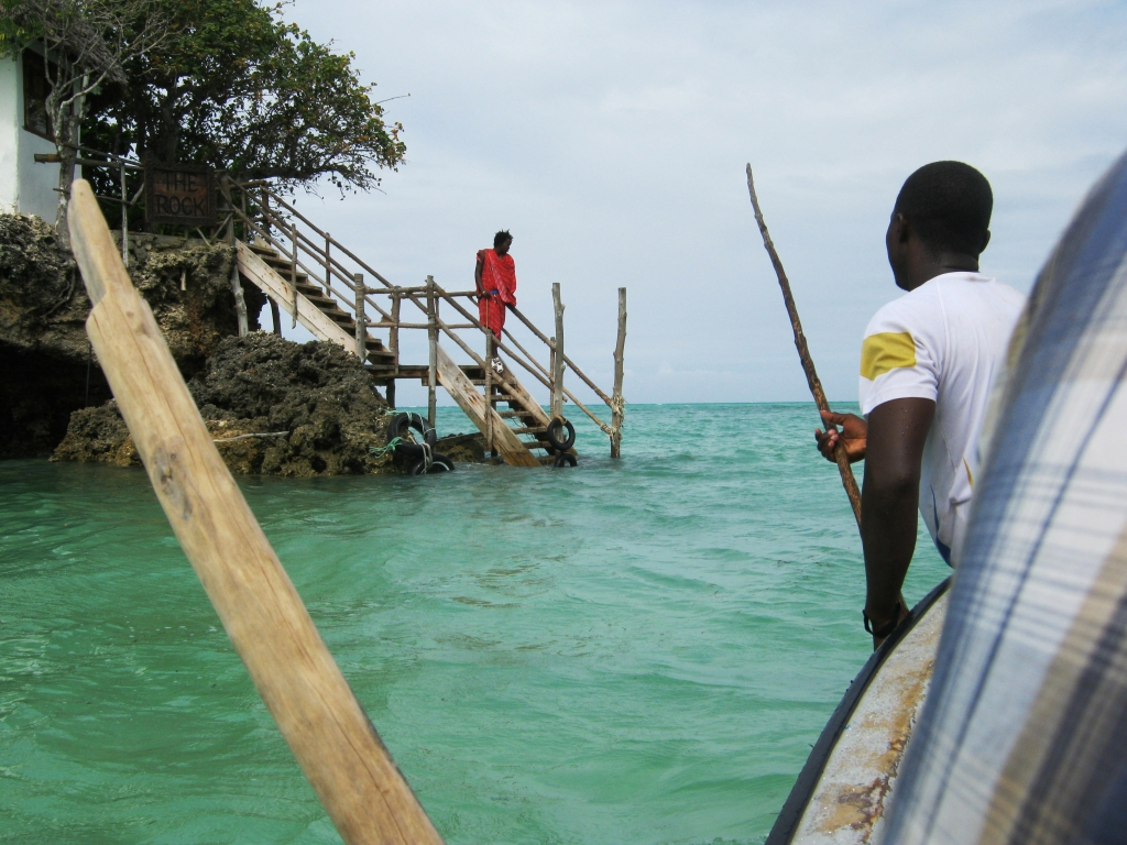 The boatman punting us to the restaurant where a Masaai was waiting to help us out of the boat